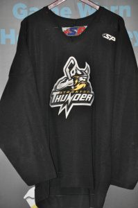 ECHL Stockton Thunder. #12 Player unknown. Black Size 56. SP Brand. Sewn on logo and numbers. Obtained from team sale.