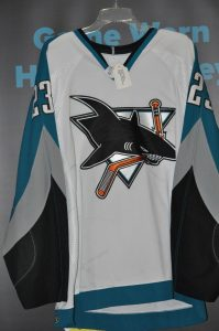 2003-04 San Jose Sharks Game Worn Niko Dimitrakos Jersey. White set #2. Size 52. This was obtained from the San Jose Sharks. Jersey shows great wear.