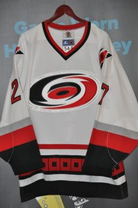 """1997-98 Carolina Hurricanes.  #27 Jay Leach Starter.  Inaugural Season """"Team Issued Jersey.""""  Set 2 stamp in hem.  White 54-R  Custom Crafted stamp inside jersey.  Obtained from team."""
